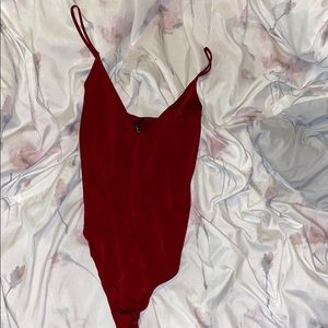 LOVE CULTURE NWT burgundy body suit